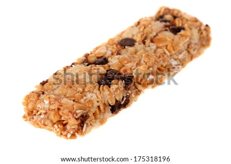 A very tasty and healthy Granola Bar chock full of Oats, Honey, Chocolate Chips, Peanuts, and other flavorful items to help make your day a bit better when your hungry for a snack. Isolated on white - stock photo