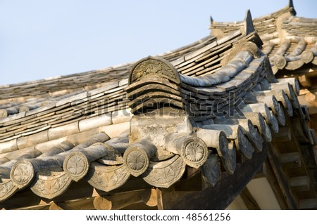 A very typical example of the tiling used in traditional Korean roofs. - stock photo