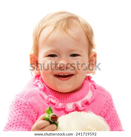 A very young blond baby girl smiling widely - stock photo