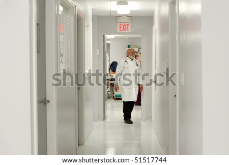 a vet walks down the corridors of a veterinary hospital - stock photo