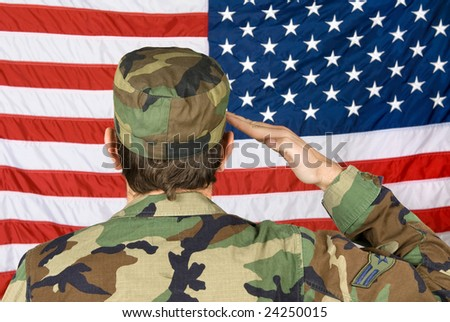 A veteran soldier salutes his flag on Memorial Day - stock photo