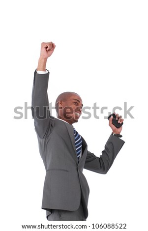 A victorious businessman holding his hands up in the air in success - stock photo