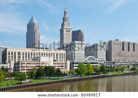A view a portion of the Cleveland, Ohio downtown business district as seen from a bridge over the Cuyahoga River with the Terminal Tower and a portion of the Tower City complex in the background - stock photo