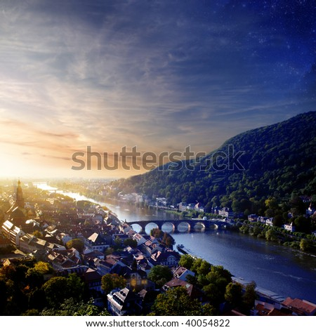 A view at the downtown Heidelberg and Neckar in Sunset.  Baden-Wuerttemberg/Germany - stock photo