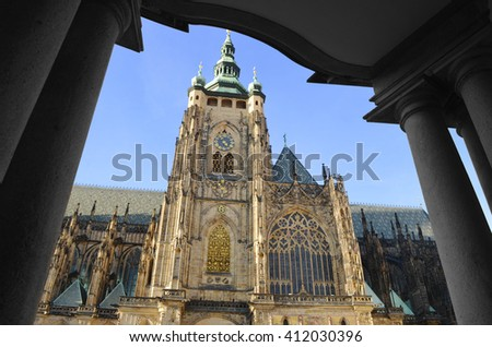 A view from south of St. Vitus Cathedral in Prague Palace, Czech Republic: the main tower and the Golden Gate - stock photo