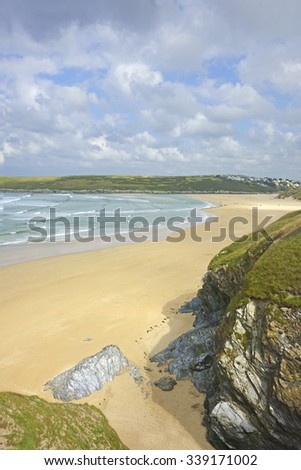 A view from the cliff tops overlooking Crantock bay and beach showing an incoming tide and beautiful sand dunes near Newquay, on the South West Coastal Path on the North Cornish coast, Cornwall, U K - stock photo