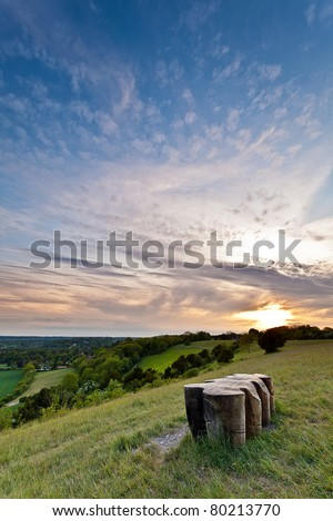 A view from the top of the North Downs hills in Surrey, England at Sunset. - stock photo