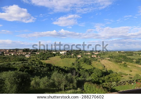 A view from Valli, a suburb of Siena, across the Tuscany countryside to the Chianti hills. A well managed rural scene in Italy. - stock photo