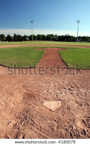 A view of a baseball diamond at dusk. - stock photo