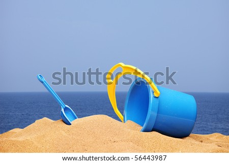 A view of a basket and scoop at the beach - stock photo