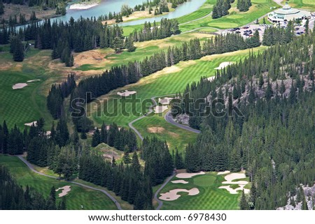 A view of a golf course from above in the mountains in Banff National Park