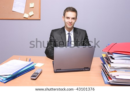 A view of a happy businessman in the office - stock photo