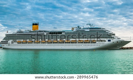 A view of a large cruise ship docked along the waterfront of Katakolon, Grece - stock photo
