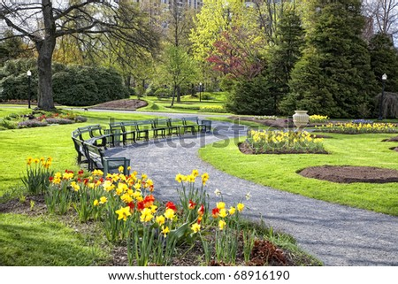 A view of a large public garden in the center of Halifax, Nova Scotia, Canada.  Full of beds of daffodils and tulips and other spring flowers. - stock photo