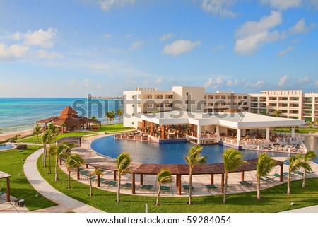A view of a luxury resort hotel under nice skies - stock photo