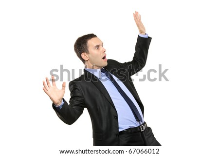 A view of a shocked young businessman isolated on white background - stock photo