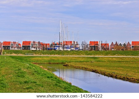 A view of a suburban area of the Netherlands and a nearby canal