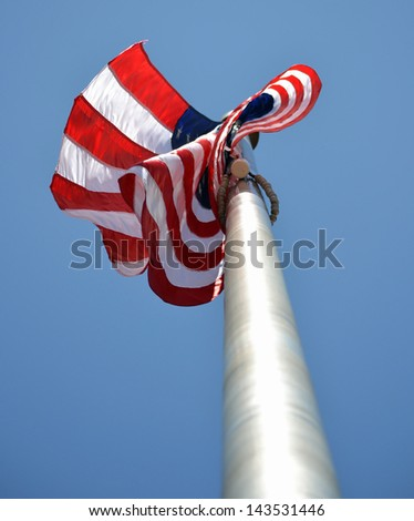 A view of a waving flag from a low angle - stock photo