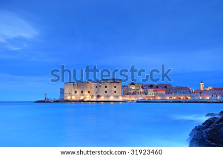 A view of an old city of Dubrovnik by night - stock photo