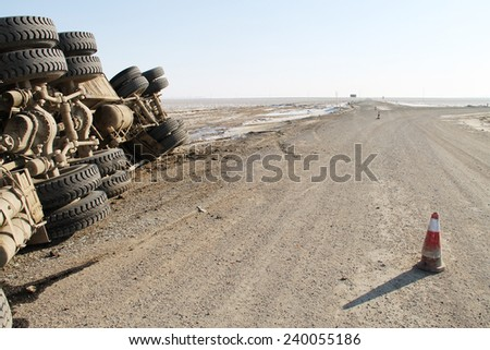 A view of an overturned truck on an desert in an accident - stock photo