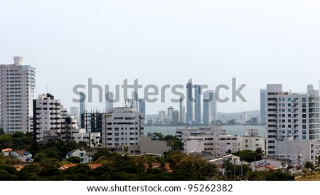 A view of apartment towers forming a white skyline in Cartagena de Indias, Colombia.