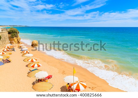 A view of beautiful sandy beach in Armacao de Pera seaside town, Algarve region, Portugal