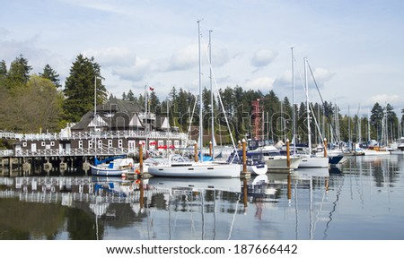 a view of coal harbour and a marina and the Vancouver rowing club in Stanley Park, Vancouver, Canada - stock photo