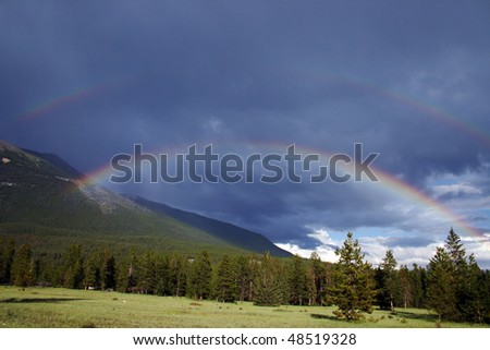 A view of double rainbow show after rain in Jasper National park. - stock photo