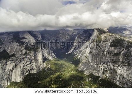A view of Half Dome and Yosemite Valley from Glacier Point in Yosemite National Park, California - stock photo