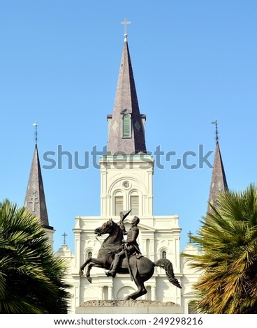 A view of Jackson Square in the New Orleans French Quarter with Saint Louis Cathedral in the background. - stock photo