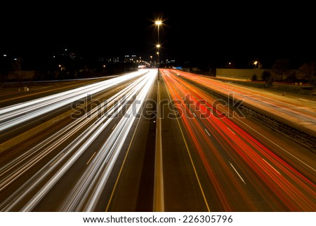 A view of Light trails on a highway - stock photo