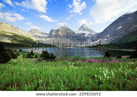 A view of Mount Assiniboine looking across Lake Magog in Mount Assiniboine provincial park British Columbia Canada - stock photo