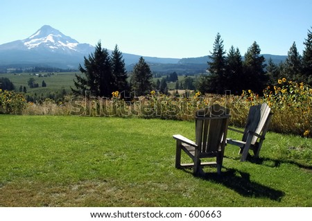 A view of Mt. Hood in Oregon from an organic apple and pear orchard - stock photo