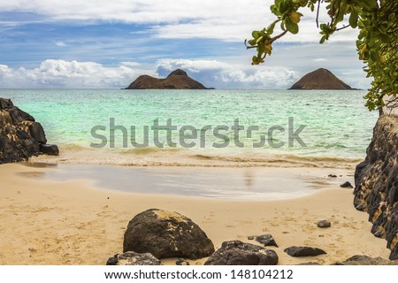 A view of Na Mokulua Islands, also known as The Mokes and Twin Islands, from the beach in Lanikai on Oahu, Hawaii - stock photo
