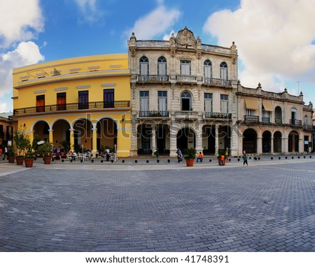 A view of Old havana plaza with typical colonial buildings in the background - stock photo