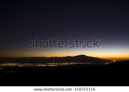 A view of Palm Springs and Coachella Valley at sunset from Key's View at Joshua Tree National Park. - stock photo
