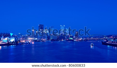 A view of Pittsburgh; Pennsylvania's skyline at night overlooking the Allegheny, Monongahela, and Ohio Rivers; Fort Pitt Bridge; Fort Duquesne Bridge; and Point State Park. HDR from five exposures. - stock photo