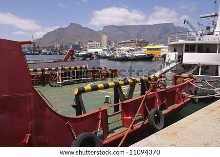A view of ships in Cape Town Harbor with Table Mountain in the background