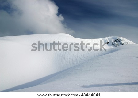 A view of snow mountain peak during snowshoeing near BC, Canada. - stock photo