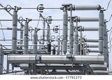 A view of some electrical power equipment in a power plant. - stock photo