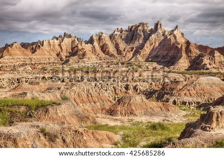 A view of some of the rugged landscape and steep hills  characteristic of the terrain in the Badlands National Park in South Dakota.