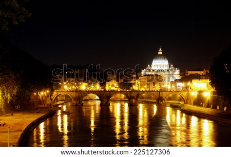 A view of St. Peter's Basilica and the Tiber River. - stock photo