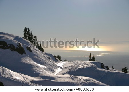 A view of sunset Vancouver in the snow peak. - stock photo