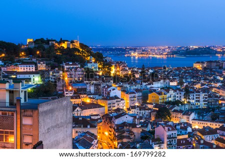 A view of the Alfama downtown at night in Lisbon, Portugal - stock photo