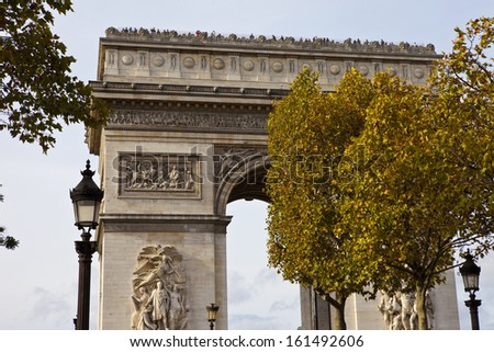 A view of the Arc de Triomphe from the Champs E'lysees in Paris. - stock photo