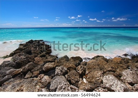 A view of the Atlantic Ocean from the rocky coast of Barbados. - stock photo