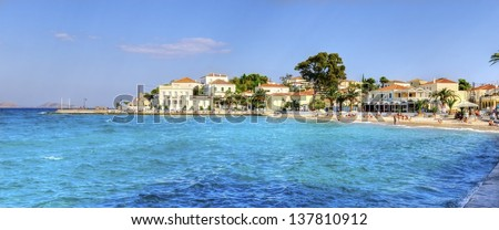 A view of the beach and some local architecture on the beautiful Greek Island, Spetses - stock photo