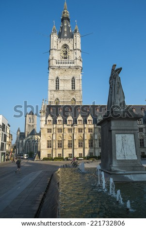 A view of the Belfry in the medeival section of Ghent, Belgium with the statue of Jan Frans Willems in the foreground - stock photo