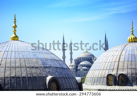 A view of the blue mosque from a window of the hagia sophia in Istanbul, Turkey - stock photo