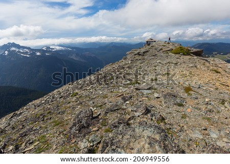 A view of the Cascade mountain range beyond Mt. Freemont Lookout in Mt. Rainier National Park, Washington - stock photo